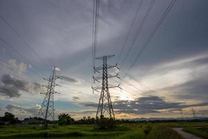 electricity power lines at sunset photo