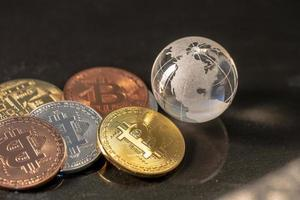 Glass globe and Bitcoin Cryptocurrency. Business concept photo