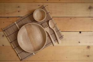 Wooden kitchenware on Natural pattern wood background. photo