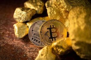 Gold bitcoin physical Bitcoin-Cryptocurrency and Gold nugget grains. Business concept photo