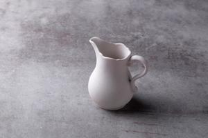 Teapot creamer, Cup and saucer on Cement Board photo