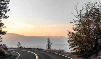 scenic winding road through yosemite national park photo