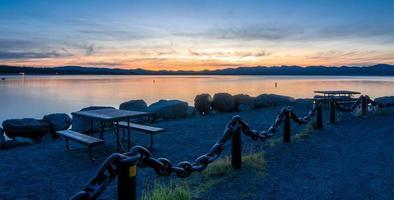 Sunrise over yellowstone lake in yellowstone national park photo