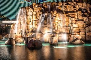 mirage hotel casino volcano fountain at night photo