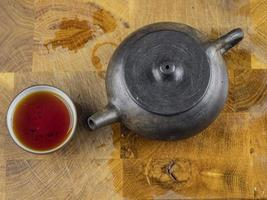 handmade clay teapot for tea with a bowl photo