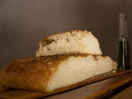 ciabatta on a wooden surface. italian bread. stirato. focaccia photo