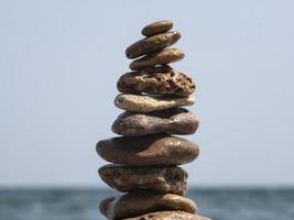 sea stones stacked on top of each other photo