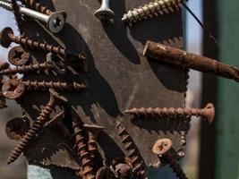 rusty screws on the magnet on the iron pole in the street photo