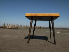 handmade coffee table stands on the sand against the blue sky. craft work photo