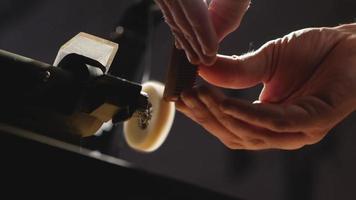 clowood craftsman polishes a handmade wooden beard comb video