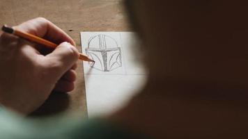 artist makes a sketch on a piece of paper video