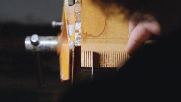 carpenter cuts the slots with a hand saw video