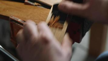 joiner removes excess thickness from a wooden board using a small plane video