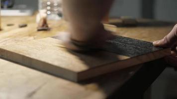 applying oil on a wooden oak board with a sponge. video
