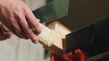 woodworker saws with a hand saw. video