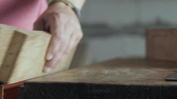 a joiner planes a wooden oak plank with a hand plane video