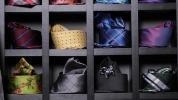 Assorted neckties or ties on display at store. Rows of hanging colorful ties in shop. photo