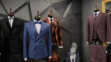 Luxury men fashion suits displaying on mannequins at store photo