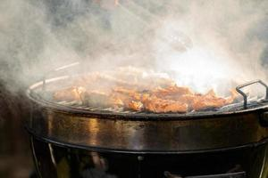 Miscellaneous delicious grilled meat over the coals on a grill photo