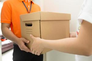 Customers receive goods from delivery man photo