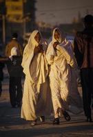 Tamanrasset, Algeria 2010- Unknown women walk in the city photo