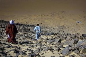 Tassili n'Ajjer, Algeria 2010- Unknown person walks in the Tassili n'Ajjer desert photo