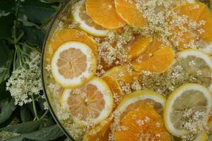 Detail Of Citrus Fruit Slice And Elderberry Juice In The Glass Bowl. photo