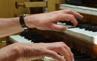 Musician Hands. Musical Performance. The Organ Concert In The Church. photo