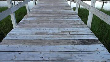 Walking on wooden board prier with pealing paint video