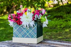 Box with beautiful flowers and white space for text photo
