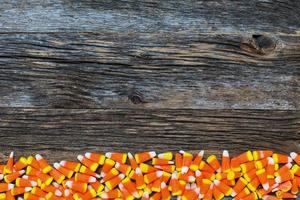 Corn candy on wooden rustic looking wooden background photo