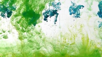 fond coloré d'encre verte et bleue video