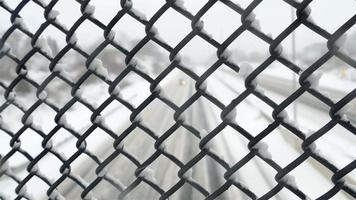 View on highway thru fence after snow storm with focusing on fence video