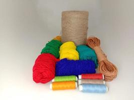 multiple colored yarn on gray background photo