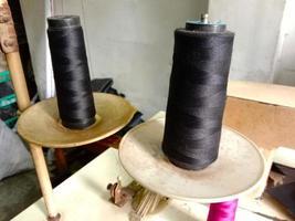 black colored yarn reel closeup photo