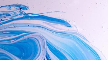 The colors of the aqueous ink are translucent. Abstract multicolored marble texture background photo
