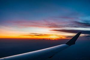 Sunset view from airplane window photo