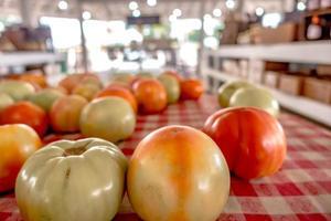 Tasty tomatoes on display at the farm market photo