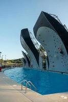 wall climbing over pool at the park photo