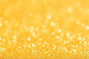 Fondo abstracto festivo brillo dorado. telón de fondo brillante desenfocado foto