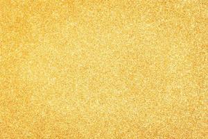 Fondo abstracto de brillo dorado. telón de fondo brillante foto
