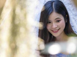 Portrait beautiful young asian woman with clean charming smile on bokeh background photo