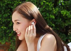 Portrait beautiful young asian woman with clean charming smile beautiful girls relax by listening to music at home on vacation. photo