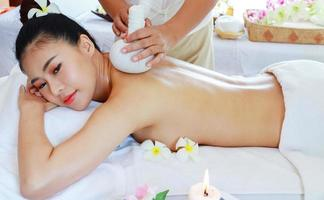 Asian woman happy are treated by professional masseuses in spa salons Healthy massage Massage to relieve fatigue and relax photo