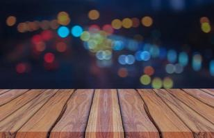 Natural wood planks on blue background abstract blur bokeh glitter for Christmas and New Year photo