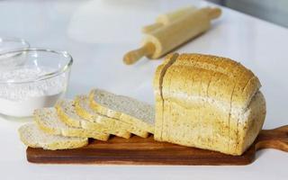 bread on dark wood floor delicious breakfast photo
