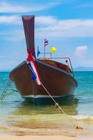 Thai traditional wooden long tail boat photo