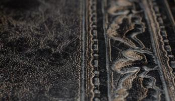 fragment of leather cover of an old book macro closeup photo