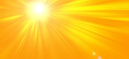 Sunny summer background with bright sun on orange background photo