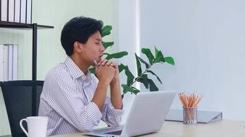 Asian businessman working with laptop in office video